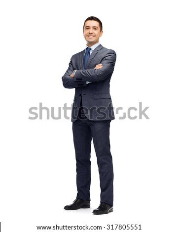 business, people and office concept - happy smiling businessman in dark grey suit - stock photo