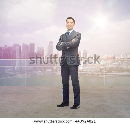 business, people and office concept - happy smiling businessman in dark grey suit over singapore city background - stock photo