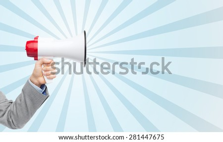 business, people and public announcement concept - close up of male hand in suit with megaphone over blue burst rays background - stock photo