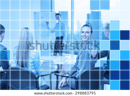 business, people and success concept - smiling businesswoman with team in office showing thumbs up over blue squared grid background - stock photo