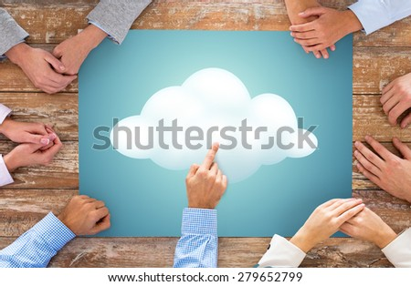 business, people and team work concept - close up of creative team hands at table pointing finger to cloud picture - stock photo