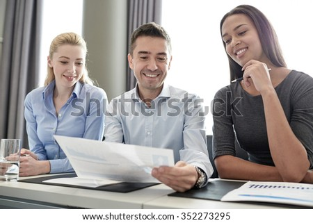 business, people and teamwork concept - group of smiling businesspeople meeting in office