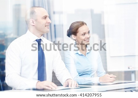 business, people and teamwork concept - smiling businesspeople meeting on presentation in office - stock photo