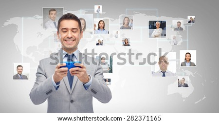 business, people and technology concept - happy businessman texting or reading message on smartphone over gray world map and network contacts background