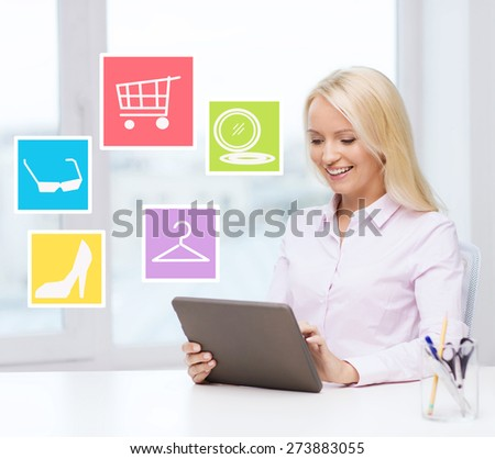 business, people and technology concept - smiling businesswoman or student with tablet pc computer shopping online in office - stock photo