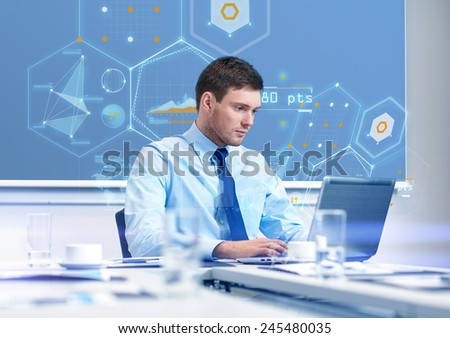 business, people and work concept - businessman with laptop computer and growth charts on virtual screen in office - stock photo