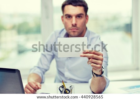 business, people, announcement and advertisement concept - businessman showing blank paper card at office - stock photo