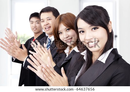 Business people applauding and welcome new partner - stock photo