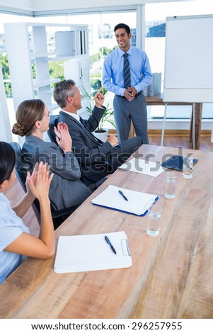 Business people applauding during a meeting in the office - stock photo