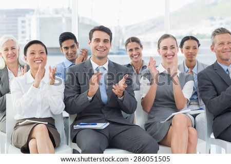 Business people applauding during meeting in office - stock photo