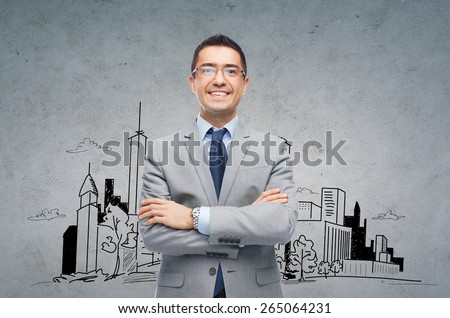 business, people, architecture and development concept - happy smiling businessman in eyeglasses and suit over gray background with city drawing