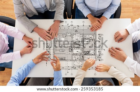 business, people, architecture and team work concept - close up of architects team hands and blueprint on office table - stock photo