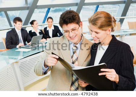 Business people are holding the notebook and reading a text - stock photo