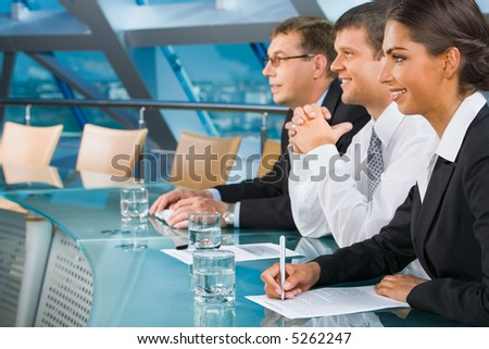 Business people are listening to the speaker of a conference with great attention - stock photo