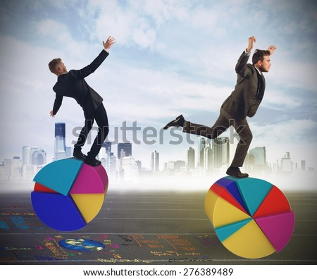 Business people as finance and economy acrobats - stock photo
