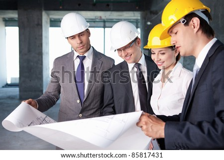 Business people at a construction site - stock photo