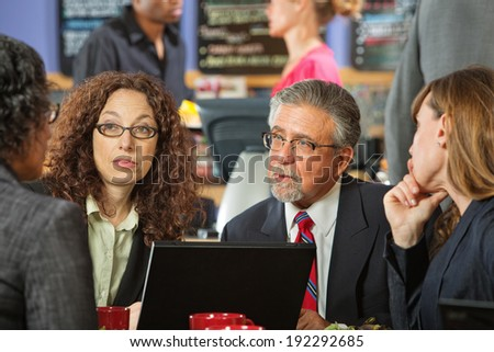 Business people at a power lunch with laptop - stock photo