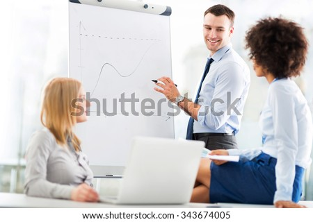 Business people at a presentation  - stock photo