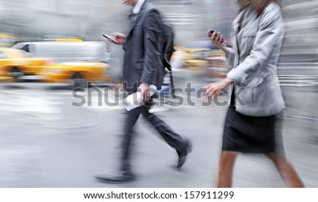 Business people at rush hour walking in the street, in the style of motion blur - stock photo
