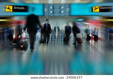 Business People at the Airport Moving with Blur - stock photo