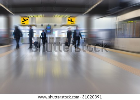 Business People at the Airport Subway - stock photo