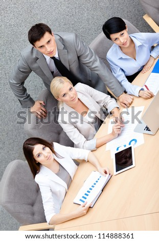 Business people at the conference discuss current issues at the modern office building. Cooperation concept - stock photo