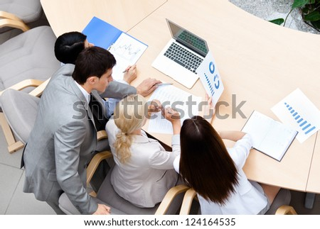 Business people at the meeting discuss current issues at the modern office building. Successful work - stock photo