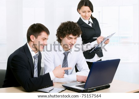 Business people at the office with a laptop - stock photo