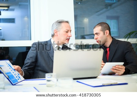 Business people at work during a work meeting - stock photo