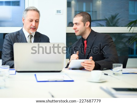 Business people at work in a modern office - stock photo