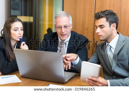 Business people at work in their office - stock photo