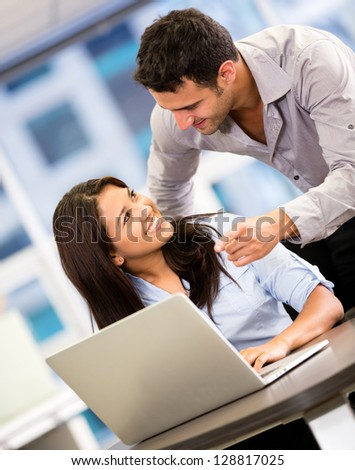 Business people at  work with a laptop computer - stock photo
