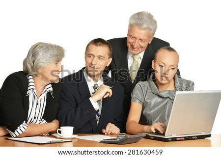 Business people at work with laptop on a white background - stock photo
