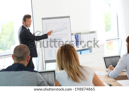 Business people attending weekly presentation - stock photo