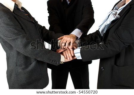 Business people  body parts with hands on top of each other ,concept of unity in business - stock photo