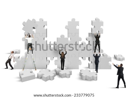 Business people builds  together a new company - stock photo