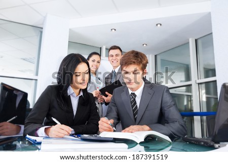 business people businessman and businesswoman working, meeting at office desk work together, businesspeople colleague team discussing report document, selective focus on background