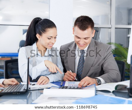 business people businessman and businesswoman working on plan in a meeting at office desk work together, businesspeople colleague team sitting at desk in office discussing report document - stock photo