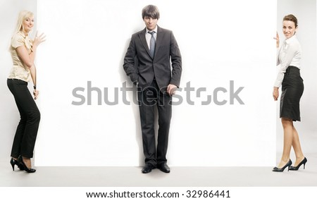Business people carrying a big white board - stock photo