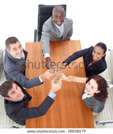 Business people celebrating a success with champagne in a meeting - stock photo
