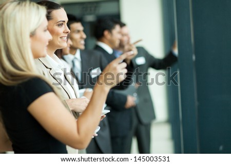 business people chatting while having tea break - stock photo