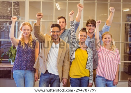 Business people cheering at the camera in the office