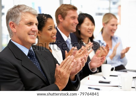 Business people clapping - stock photo