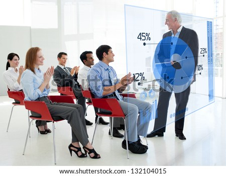 Business people clapping stakeholder standing in front of blue pie chart interface in a meeting - stock photo