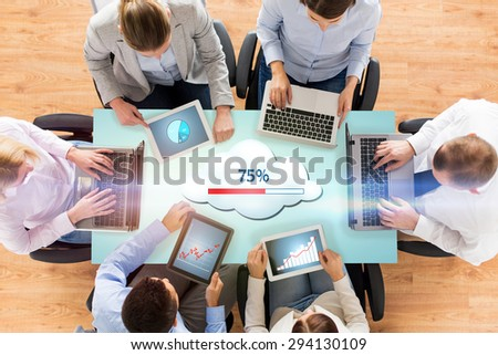business, people, cloud computing and technology concept - close up of creative team with laptop and tablet pc uploading data to server at office - stock photo