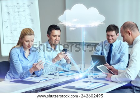 business, people, cloud computing and technology concept - smiling business team with smartphones, tablet pc computers working in office - stock photo