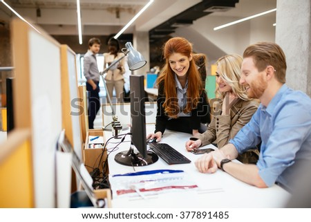 Business people collaborating in office and working on project together - stock photo