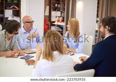 Business people communicating at meeting in office - stock photo
