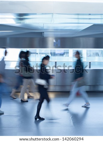 Business people commuting (abstract blurred motion)
