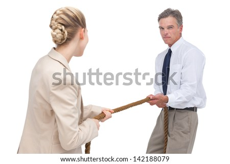Business people compete a tug of war on white background - stock photo